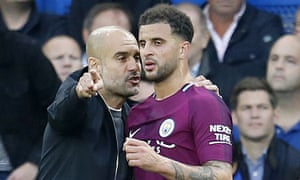 Pep Guardiola talks tactics with Kyle Walker during Manchester City's game at Chelsea