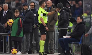 Referee Gianluca Rocchi consults VAR before awarding Roma a penalty.