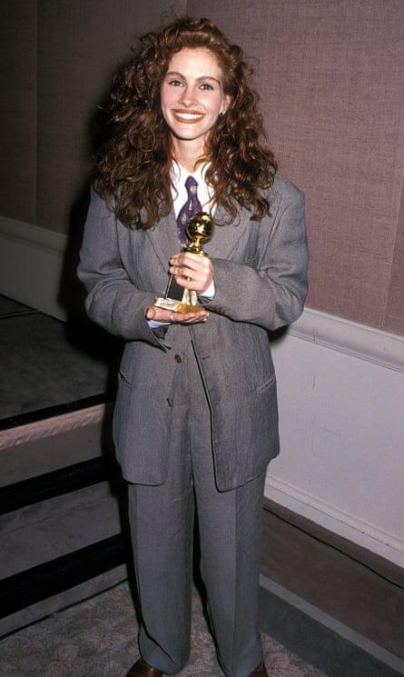 Julia Roberts wearing an Armani suit at the 1990 Golden Globe awards.