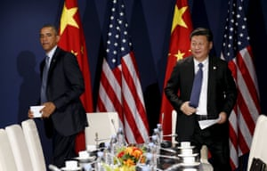 US president Barack Obama and Chinese president Xi Jinping take their seats for their meeting at the start of the climate summit in Paris