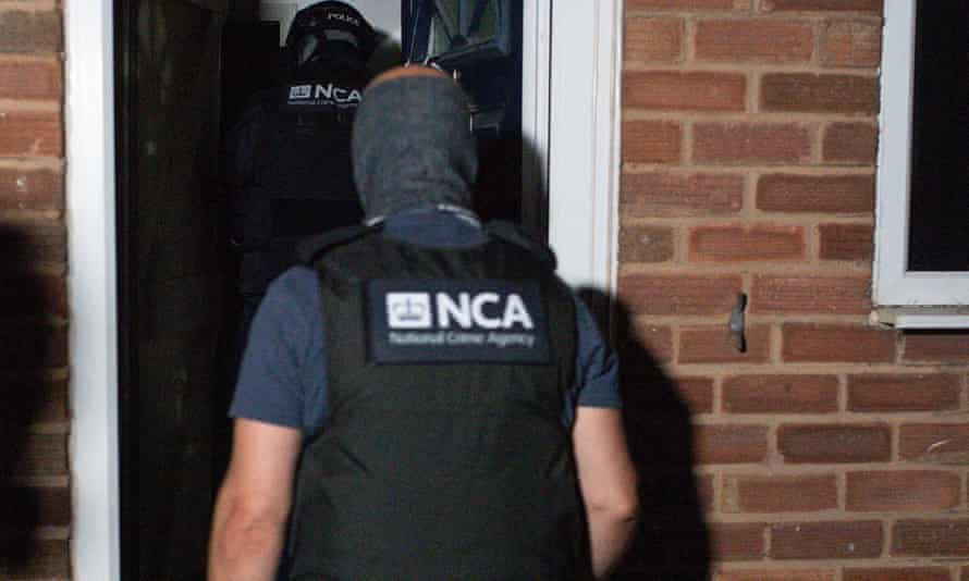 The National Crime Agency and police take part in a June raid on a property in Birmingham related to the investigation on Encrochat.