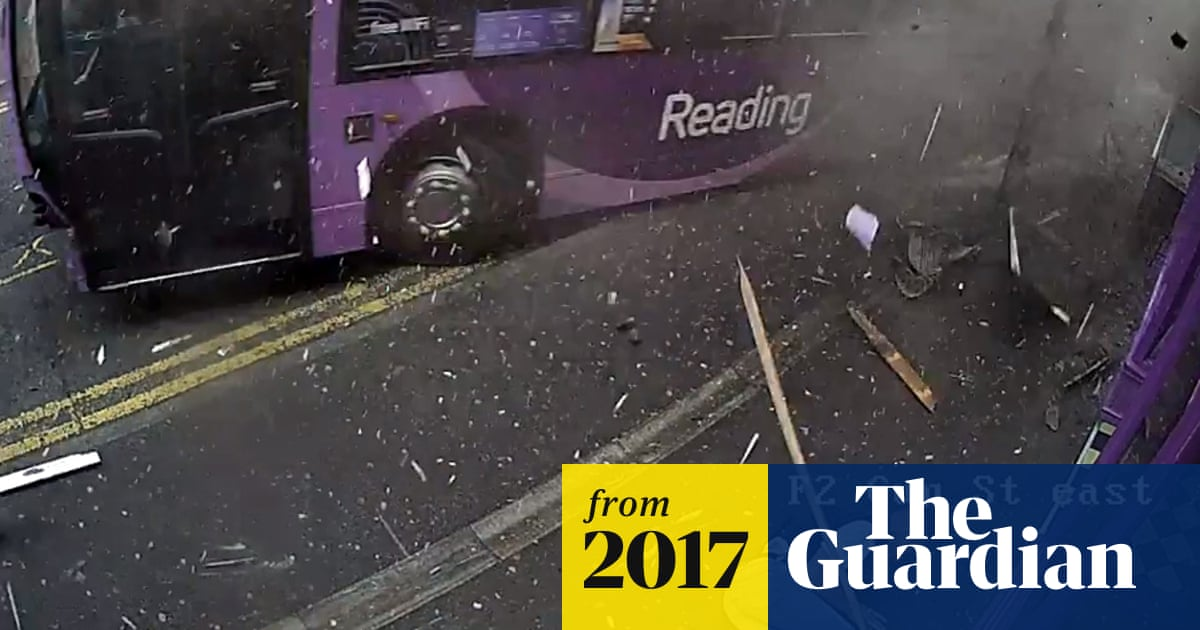 Man hit by bus in Reading survives without injury - video | UK news