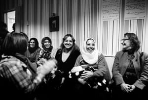 Volunteers from Nagu and refugees laugh together during a New Year's Eve concert put on by local musicians. Hardly a day goes by without an activity that brings the locals and the guests together. After the concert, the Afghan families asked if they could sing a traditional song; the sadness in their voices left the room in tears.
