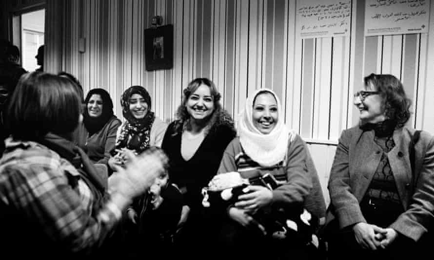 Volunteers from Nagu and refugees laugh together during a New Year's Eve concert put on by local musicians.