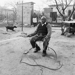 Ephraim Zulu watering his garden, 179 Central Western Jabavu, Soweto, September 1972.