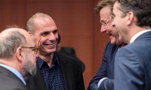 Dutch Finance Minister Jeroen Dijsselbloem, right, and Belgium's Finance Minister Johan Van Overtveldt, 2nd right, talk with Greek Finance Minister Yanis Varoufakis, 2nd left, today.