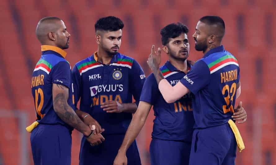 India's Shardul Thakur celebrates with teammates after getting his team over the line.