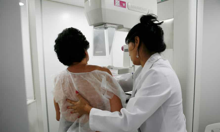 A woman undergoes a mammogram/breast cancer screening