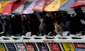 The bookmakers take cover at a rainy Newmarket on Friday.