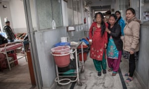 Relatives of a patient affected by cancer help her to walk in one of the corridors inside the Bhaktapur Cancer Hospital in Nepal.