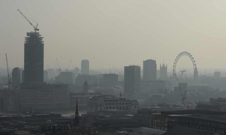 Air pollution obscures the view of the London eye in central London