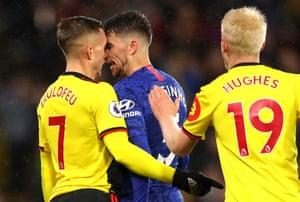 Jorginho of Chelsea squares up to Watford's Gerard Deulofeu.