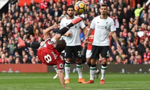 Dejan Lovren, right, and Emre Can watch as an unmarked Juan Mata nearly scores a third goal for Manchester United with an overhead kick