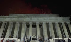 US President-elect Donald Trump and family pose at the end of a welcome celebration as fireworks go off overhead at the Lincoln Memorial.