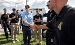 Governor Rick Scott, center, shakes hands with first responders brought in to help with Hurricane Michael relief on 11 October in Panama City Beach, Florida.