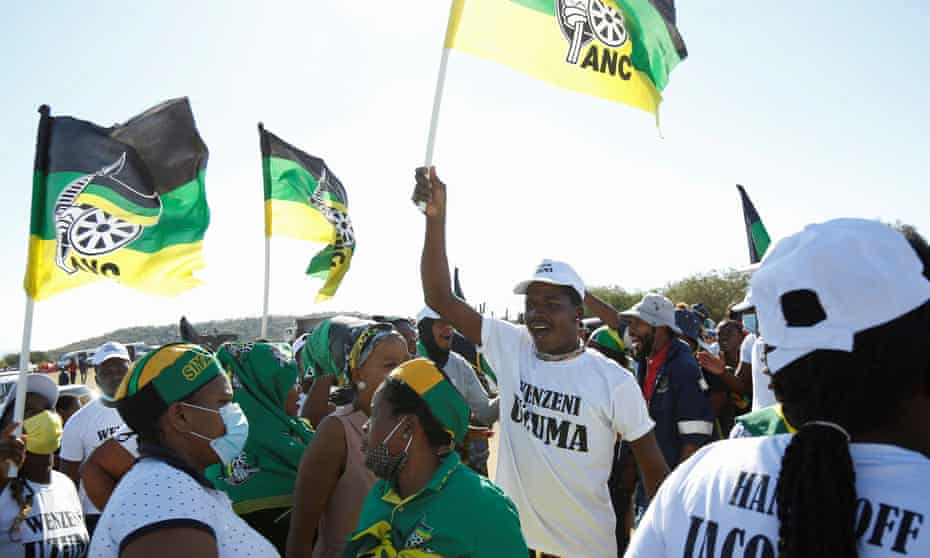 Supporters of former South African President Jacob Zuma, who was sentenced to a 15-month imprisonment by the Constitutional Court, sing and dance in front of his home in Nkandla