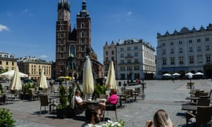 Locals in Kraków's Unesco-listed Main Square