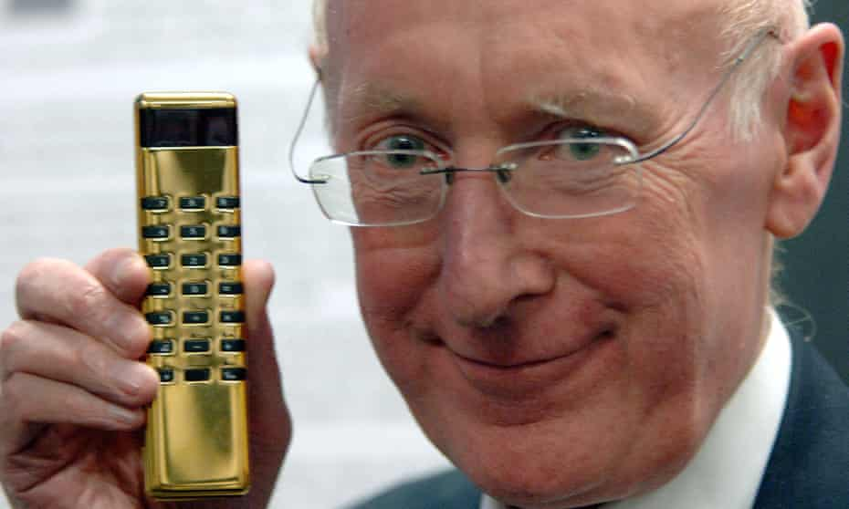 Sir Clive Sinclair displaying a gold Sinclair calculator  in 2006.