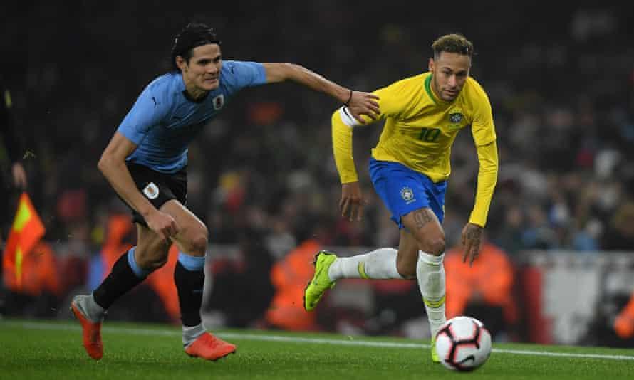 PSG teammates Edinson Cavani and Neymar battle for the ball.