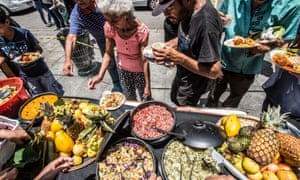 Farmers, activists and chefs lay on a street banquet in Sao Paulo in protest at an ultimately unsuccessful proposal by mayor João Doria to make farinata poor people from food nearing its expiry date