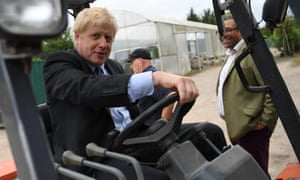Boris Johnson drives a forklift truck during a leadership campaign visit to a nursery in Braintree, Essex