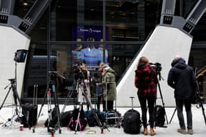 Members of the media gather outside the headquarters of the Premier League in London.