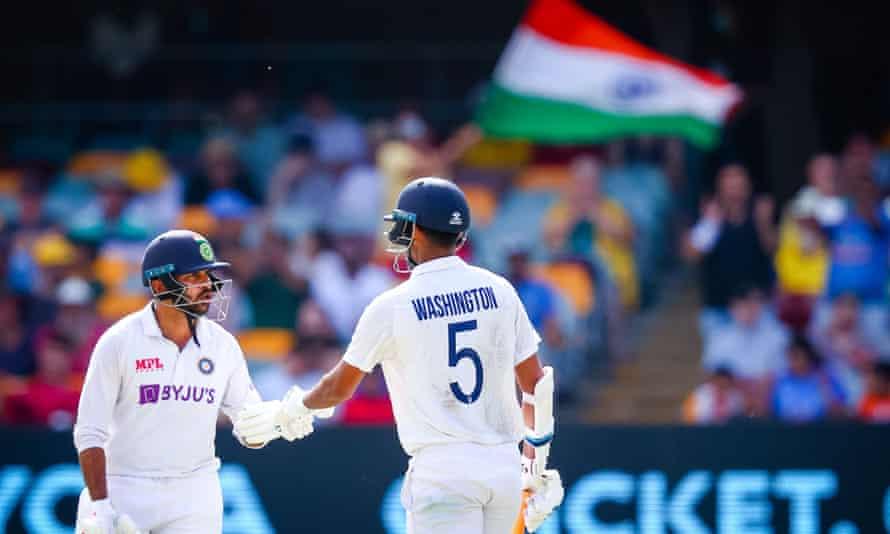 Washington Sundar (right) is congratulated by Shardul Thakur