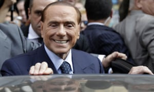 Berlusconi getting into a car