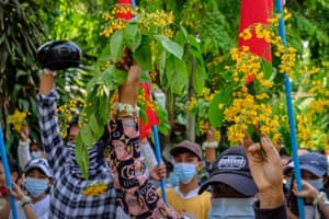 People in Myanmar lay flowers in public places in remembrance of 'heroes who can't come back home'