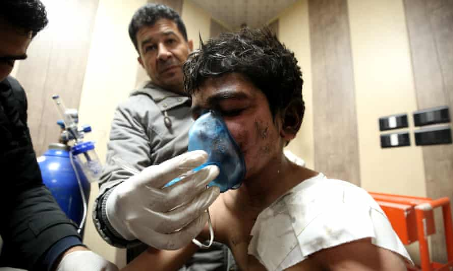 A boy receives treatment at a field hospital after airstrikes hit central Idlib last month