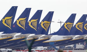 Ryanair jets parked up on the runway of Dublin airport.
