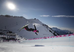 Andrew Longino of Canada twists in the air during qualifying for the freestyle skiing men's halfpipe.