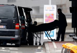 The body of a victim is removed from Maelbeek Metro station a day after multiple terrorist attacks