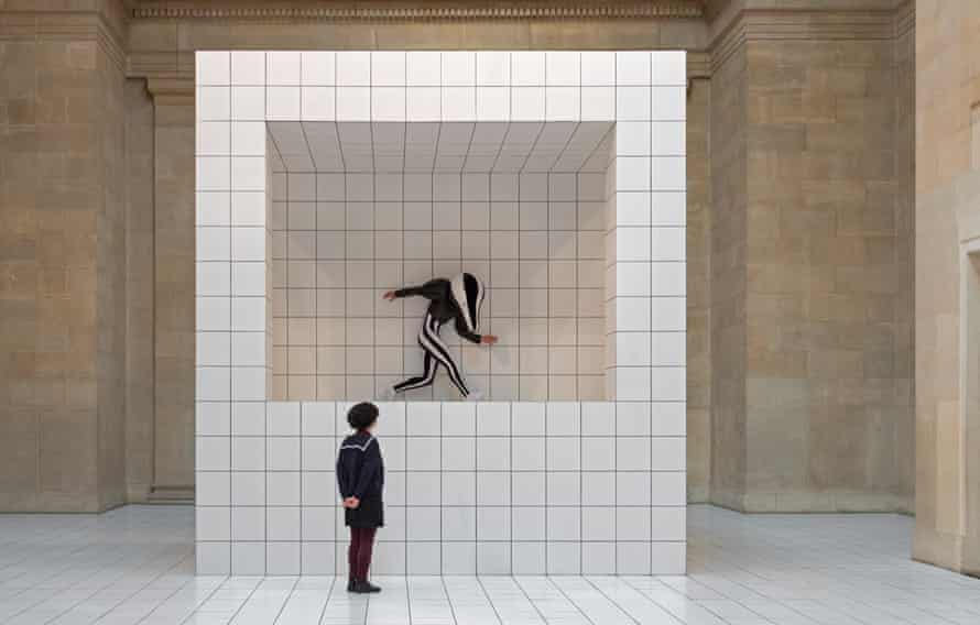 A badger-like performer poses in Anthea Hamilton's The Squash at Tate Britain.