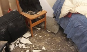 An asylum seeker's room in Greater Manchester where the ceiling collapsed twice in six months.