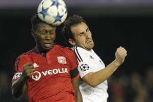 Lyon's Mapou Yanga-Mbiwa, left, beats Paco Alcacer in the air.