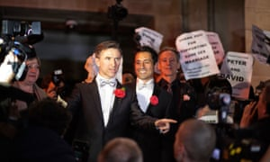 Peter McGraith (left) and David Cabreza, the first gay couple to marry, at their wedding
