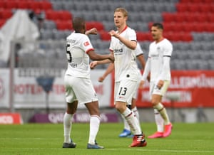 Martin Hinteregger (right) celebrates after scoring his, and Frankfurt's, second goal by a fist bump with Gelson Fernandes .