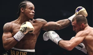Anthony Yarde looks to land a left hand on Sergey Kovalev in their WBO light-heavyweight title bout