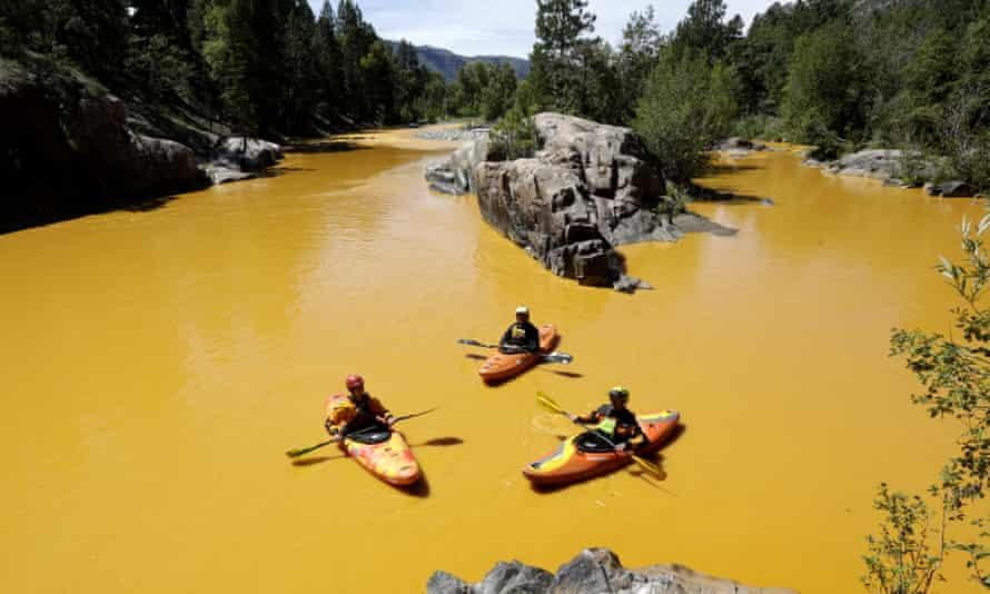 People kayak in the Animas River near Durango, Colo., Thursday, Aug. 6, 2015