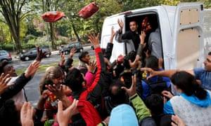 Berlin, Germany: Turkish volunteers distribute water and snacks to people queuing