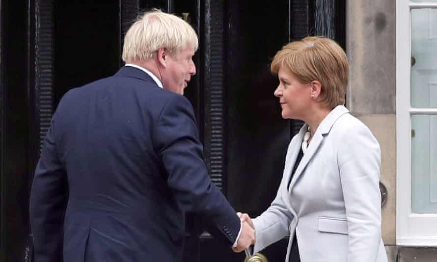 Nicola Sturgeon welcomes Boris Johnson during his trip to Scotland in July last year.