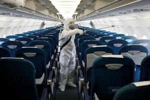 Hanoi, Vietnam: A health worker sprays disinfectant in a Vietnam Airlines jet at Noi Bai airport. Many carriers have cancelled flights to and from China since the outbreak of coronavirus