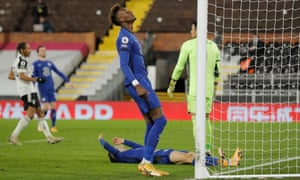 Chelsea's Christian Pulisic (on floor) and Tammy Abraham react after they both couldn't reach to ball to turn it in.