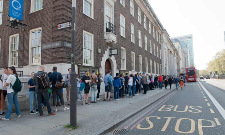 People queue outside Friends House in London