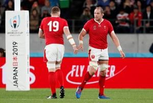 Wales' Alun Wyn Jones walks past teammate Jake Ball as he leaves the pitch to a standing ovation.