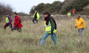Members of the public looking for Gaia Pope in Durlston country park, Dorset.
