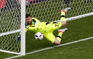 Matus Kozacik keeps out Gareth Bale's header.