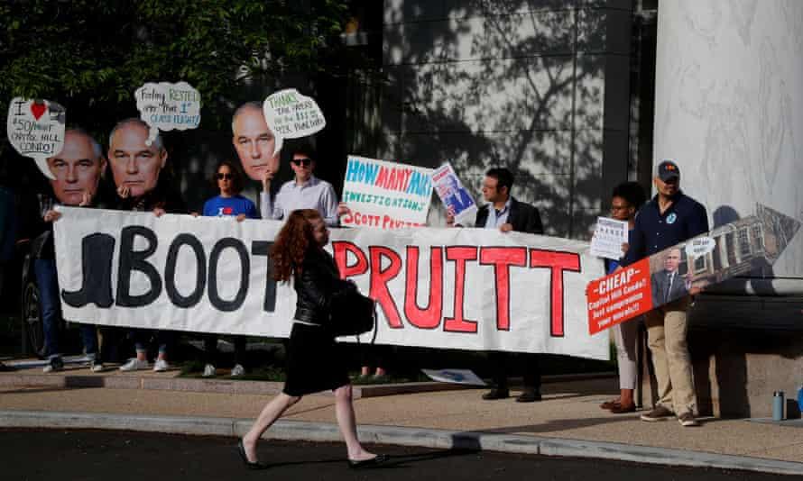 People protest Scott Pruitt in Washington DC on 26 April 2018.