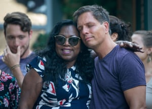 Don Damond, the fiance of Justine Damond, is comforted outside his home by Valerie Castile, the mother of Philando Castile.
